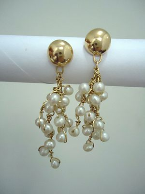 Gold and pearls earrings. By Mauro Cateb, Braz...